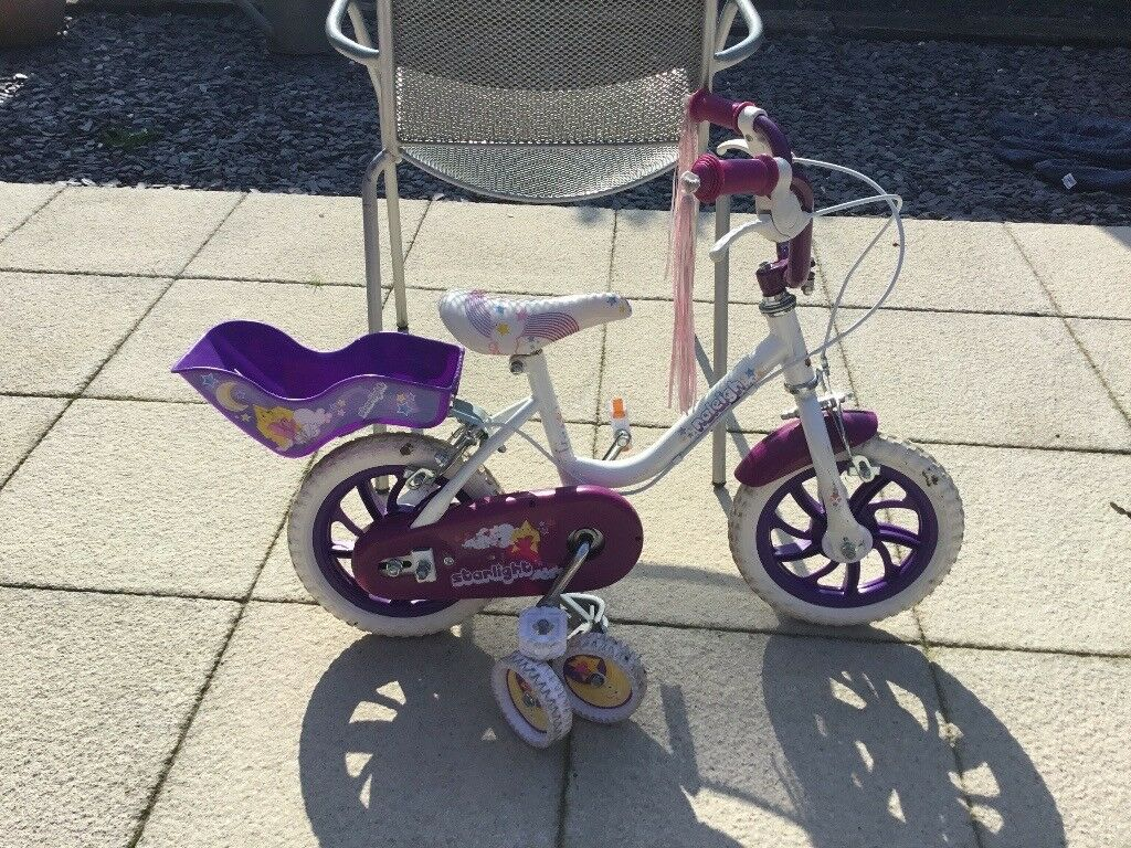 "Raleigh 12"" girls bike with stabilisers and dolly carrier"