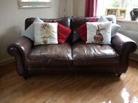Aged brown leather double sofa bed