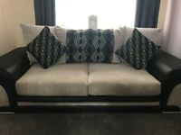 Nearly new sofa and chair with very little use, no damage or marks.