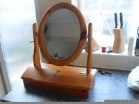 PINE MAKE UP MIRROR IS BRAND NEW WITH A COMPARTMENT FOR MAKE UP ETC CAN DELIVER LOCALLY