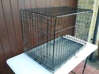 Two medium size dog / pet cages