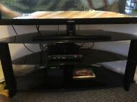 Black glass tv stand / unit with shelf rounded back