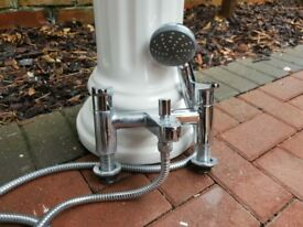 Bath mixer taps with shower attachment in chrome
