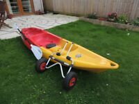 Feelfree Nomad Kayak in red and yellow