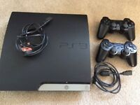 PS3, 2 x Controllers and 8 Games