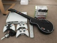 Xbox 360 250Gb + 1 controller + Guitar Hero pack + DVD remote + wireless earpiece + 10 games