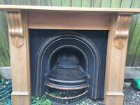 Cast iron fire place and pine surround