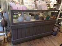 Painted display cabinet on wheels