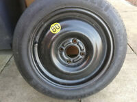 ford spacesaver wheel with a pirelli T125/80 r15 tyre and jack and clamp