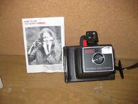 Polaroid Swinger camera. It's still in its box, with original instruction leaflet.
