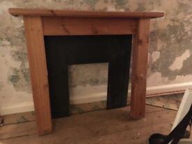 Wooden fire surround and back panel