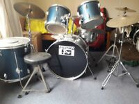 Beginners drum kit including sound dampeners and stool.