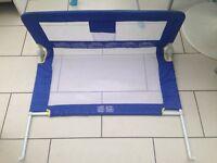 Blue tomy fold down soft bed rail