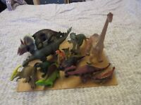 Various children's dinosaur figures