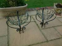 Two wrought iron plant basket holders