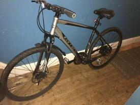 Carrera men's mountain/hybrid bike