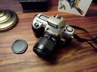 Nikon F60 SLR Camera with 35-80mm lens, assorted filters, camera case and tripod