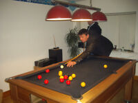 6ft pool table,slate bed with lights, several cues and amarith pool and snooker balls balls