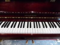 modern upright piano by hyundai one lady owner