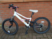 Girls' Bike, suitable for 5 - 9 years old. 6 gears, front and rear suspension and cycle computer.