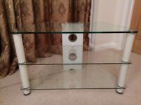 Glass TV stand / television unit with two shelves under television