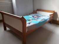 A wooden junior bed including mattress only £30
