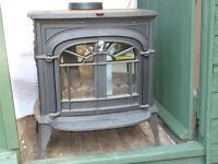 """Wood burner stove"" PLG (calor gas or sim) Trad. design.VGC. Heavy cast iron. Black w brass handles"
