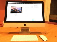 21.5 inch iMac, with original packaging, 6 month apple warranty