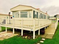 JUST INTO STOCK AT SANDY BAY IS THIS DOUBLE GLAZED CARAVAN AT A STUNNING PRICE - OPEN 12 MONTHS