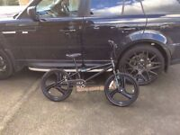 Black Boys Zinc BMX Bike + Pink Kawasaki girls BMX bike