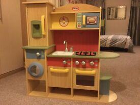 Wooden toy kitchen, accessories, dishes and play food.