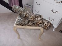 Shabby chic dressing table stool and matching bolster cushion in animal print