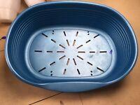 Medium blue plastic oval bed