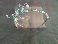 Beautiful wedding tiara with green and clear crystal design on a silver headband