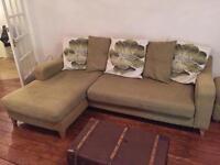 Green four seat corner sofa and foot stool