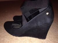 Black suede Clarks wedge shoes.