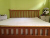 Wooden Super King Size Bed. With spring loaded slats. Good condition. From Feather and Black.