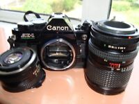 Canon AE!-P 35mm Film Camera 50mmPrime lens and 28-70 zoom lens.