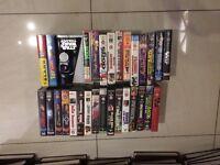 A job lot of VHS movies - titles such as original Star Wars Trilogy, Jurassic Park, Terminator 2