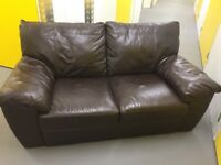 Two brown leather sofas: one two seater, one three seater and footstall