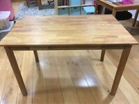 SOLID OAK TABLE AND 2 MATCHING DINING CHAIRS