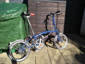Brompton two speed fold up bike in blue