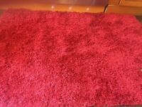 2 ...NEXT RED SHAGGY RUGS £40 both