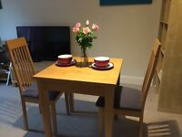 Dinning table and chair- very good condition- city center