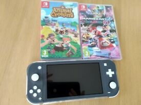 Nintendo switch lite with Mario Kart and Animal Crossing