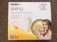 Medea Swing breast pump & 3 brand new unused bottles