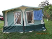 apache awning 750 size very good condition with poles and curtain