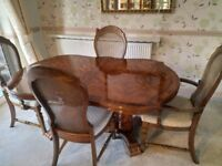 Solid walnut dining extendable table to seat up to eight two carvers and four chairs