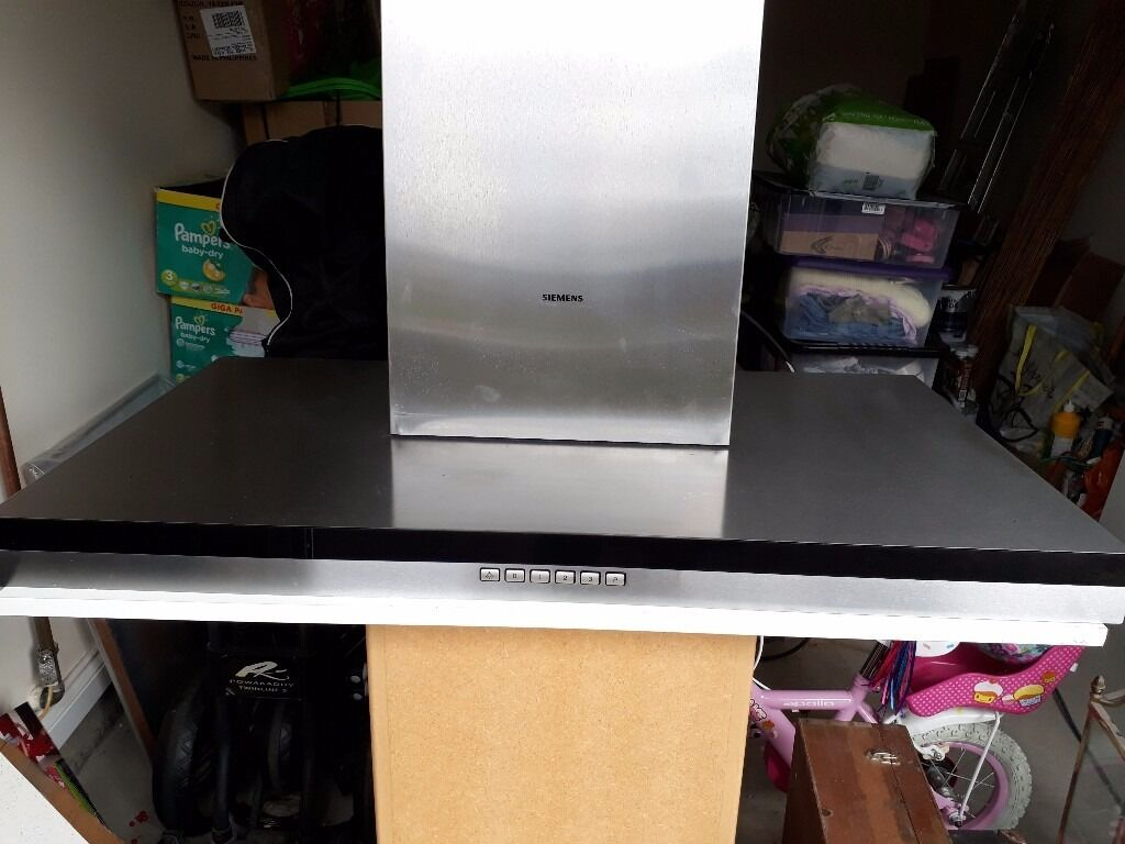 Siemens iQ300 Extractor Hoodin Portlethen, AberdeenGumtree - Siemens iQ300 Extractor Hood Stainless steel and black glass. Feature lights. In immaculate condition. Only 2.5 years old. From smoke free home. Also selling Siemens Gas Hob, please see my other ads