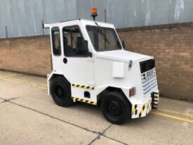 FMW diesel tow tug/ tractor. With trailers good working order